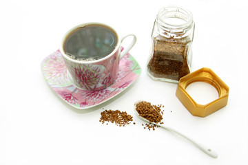 Open jar  and cup with instant coffee