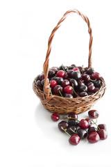 Cherries in a wicker basket.