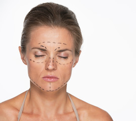 Portrait of woman with plastic surgery marks on face