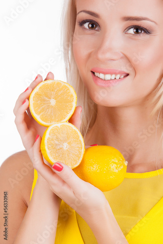 Portrait of a beautiful woman with lemon fruit