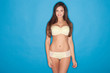 woman with a lovely body standing  in yellow lingerie