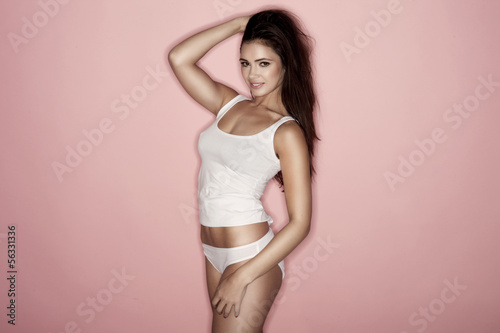 Sexy woman wearing white shirt and white lingerie