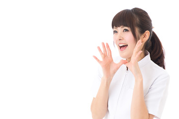 young asian nurse yelling on white background