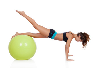 Woman doing pilates with a ball