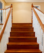 Beautiful foyer looking down hardwood stairs in new house