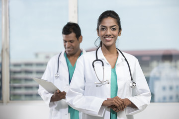 Female Indian doctor with her colleague