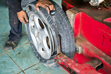 Auto mechanic changing car wheel