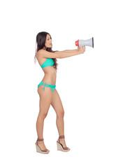 Beautiful woman in bikini with megaphone