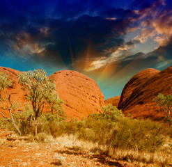Beautiful rocks of Australian Outback against colourful sky