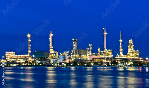 Oil refinery plant illuminated at dusk