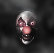 Dark evil clown face with scary joker smile