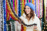 Young Woman Choosing Tinsels At Store