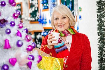 Beautiful Senior Woman In Christmas Store