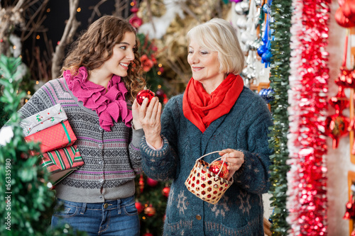 Happy Mother And Daughter In Christmas Store