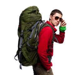 Hiker with backpack standing at white background