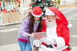 Girl And Santa Claus Using Digital Tablet