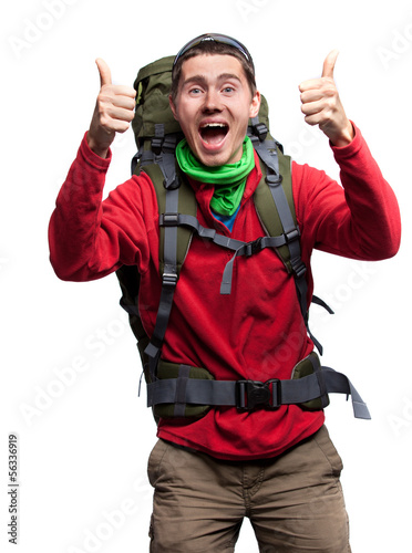 Full length portrait of a hiker with backpack posing isolated