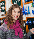 Woman Shopping Ornaments In Christmas Store