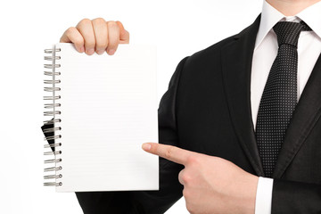 Isolated businessman holding a notebook or piece of paper