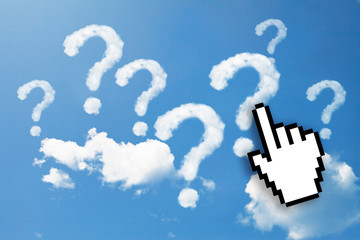 Digital icon hand  on question mark clouds background