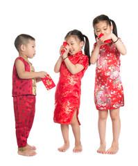 Asian children peeking into red packet