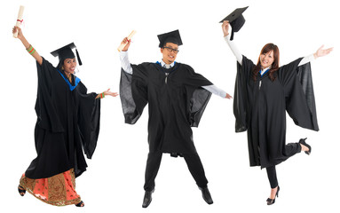 Multi races university student in graduation gown jumping
