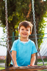 Little boy at swing