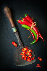 Hot chili pepper  and vintage knife for chopping herbs