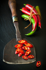 Hot chili and antique knife for chopping herbs