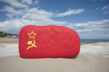 The Union of Soviet Socialist Republics flag on a stone