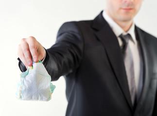 Businessman holding a dirty diaper