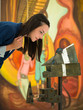 woman closely analyzing contemporary sculpture
