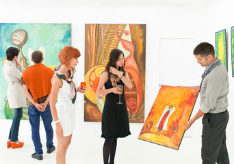 art collectors at exhibition opening