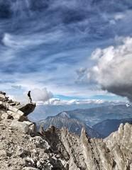 Man on edge of a mountain