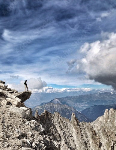 Man on edge of a mountain