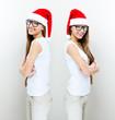 Christmas Santa hat  woman portrait . Smiling happy girl .