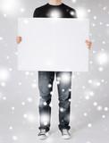 man showing white blank board