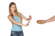 Discontent young female refusing fast food