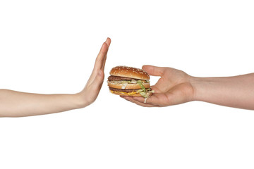 Female hand refusing the fast food meal