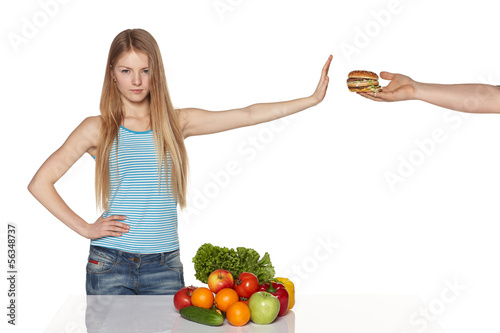 Serious young female refusing fast food