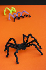 Spider for Halloween craft, black on orange.