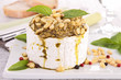 cheese with pesto sauce and nuts