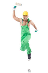 Painter in green coveralls on white