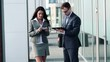 Businesspeople with tablet and smartphone by office building