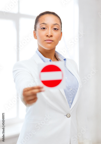 african woman showing stop sign