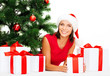 smiling woman in santa helper hat with gift boxes