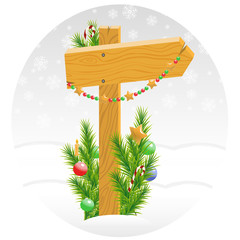 Wooden arrow decorated with Christmas toys