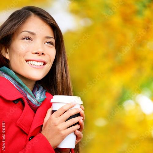 Coffee woman drinking coffee outside in fall