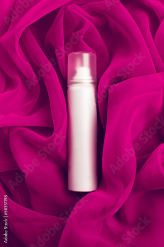 Beauty spray (aerosol) over pink (purple) vapory cloth