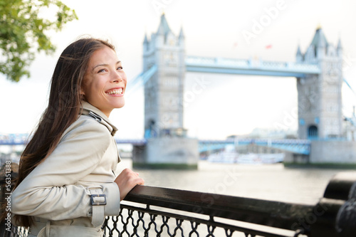 People in London - woman happy by Tower Bridge
